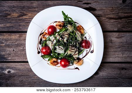 Salad With Mozzarella Cheese, Tomatoes And Basil A