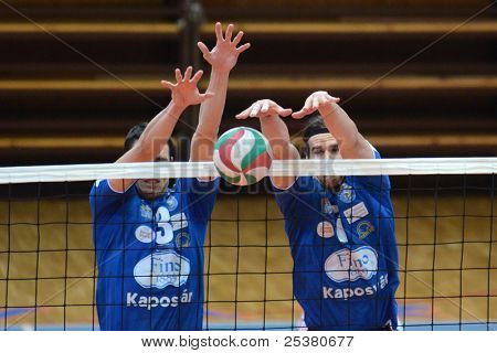 KAPOSVAR, HUNGARY - NOVEMBER 13: Andras Geiger (blue 7) in action at a Hungarian National Championship volleyball game Kaposvar (blue) vs. Nyiregyhaza (red), November 13, 2011 in Kaposvar, Hungary.