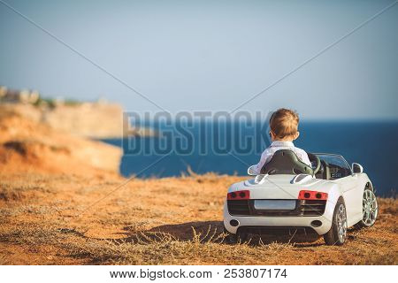 Traveling And Education. Childhood And Happiness. Car With Small Boy. Happy Kid In Toy Car. Child Dr