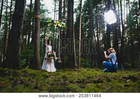 Professional Wedding Photographer Using Strobe And Softbox To Make Pictures
