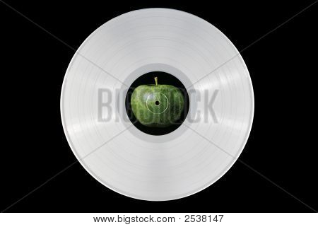 White 33 rpm record with an apple label. poster