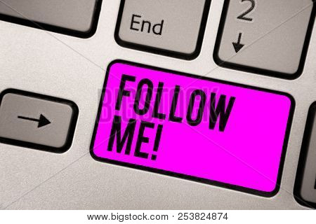 Text sign showing Follow Me. Conceptual photo Inviting a person or group to obey your prefered leadership Keyboard purple key Intention create computer computing reflection document. poster