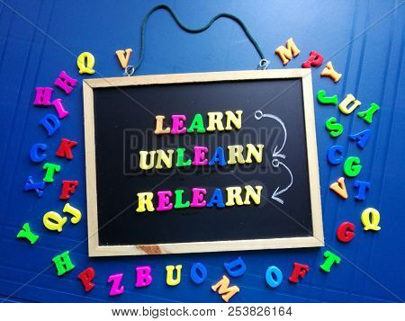 Learn, unlearn and relearn, written on blackboard
