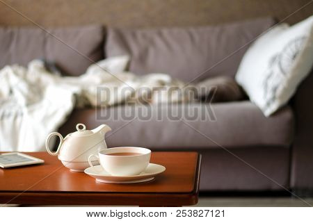 Cozy Home Interior With Teapot, Cup Of Tea And Ebook. Horizontal
