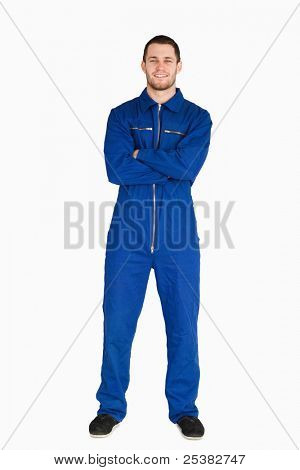 Smiling mechanic in boiler suit against a white background