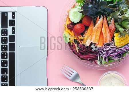 Fresh Salad Vegetables With Computer Laptop At Workplace For Diet And Heathy Lunch Eating Concept