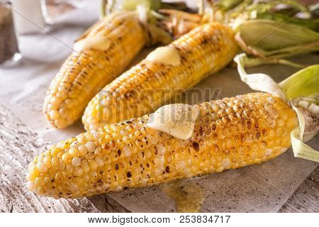 Delicious Barbecue Grilled Corn On The Cob With Salt, Pepper And Melted Butter.
