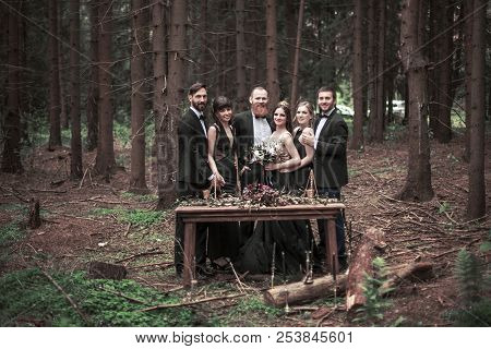 Portrait Of The Couple And Witnesses At The Picnic In The Woods