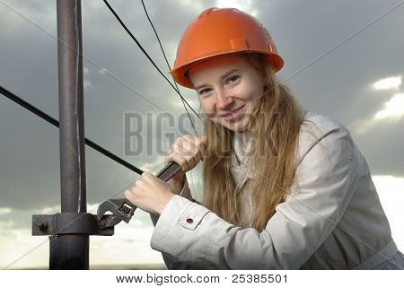 Smiling girl with a wrench