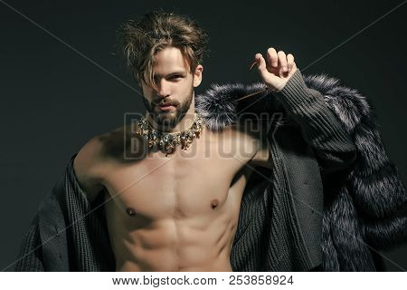 Man With Fur Coat On Grey Background. Cinderella Prince With Crown And Muscular Torso, Chest. Freak,
