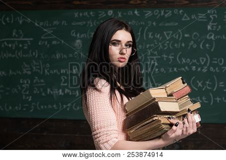 Focused On Exam. Girl Student Preparing For Examination. Student Excellent Fond Of Studying. Diligen