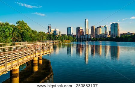 Austin , Texas , USA reflection of Town Lake Downtown Skyline Cityscape urban modern symmetry of the skyscrapers reflecting off water of Colorado River  poster