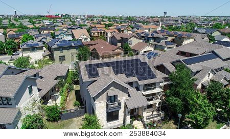 Suburbs And Suburban Facades And Hundreds Of Solar Panel Rooftops And Homes Wrapped Around Green Lan