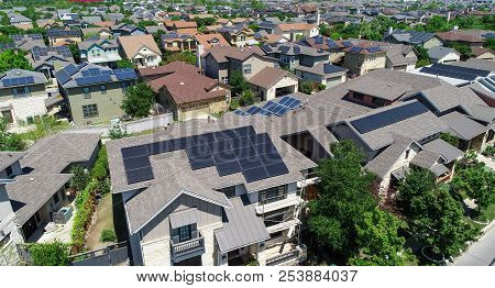 Facades And Hundreds Of Solar Panel Rooftops And Homes Wrapped Around Green Landscape In Mueller Dev