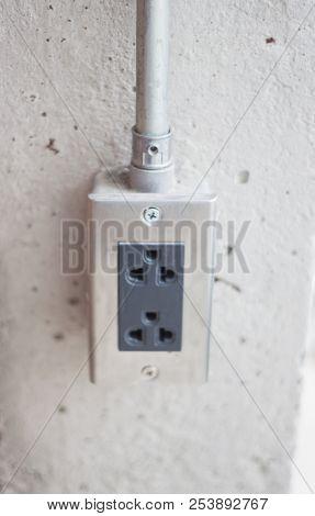 Power Socket On Concrete Wall, Stock Photo