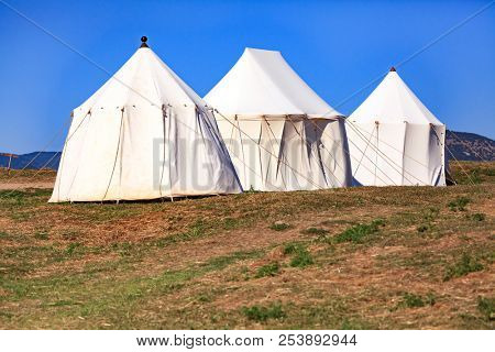 Three tents under the blue sky