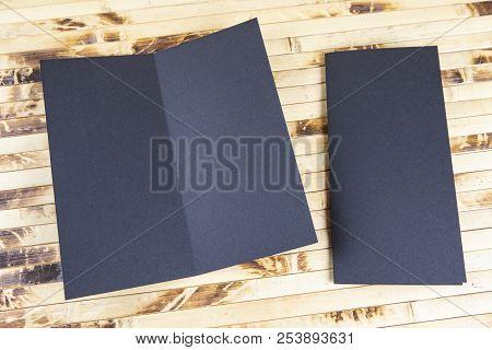 Mockup Of Black Booklet On Bamboo Background.