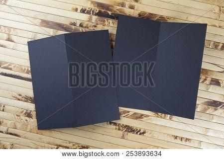 Mockup Of Black Booklet On Bamboo Background