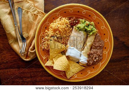 Authentic Mexican Burrito And Taquito Dinner With Rice And Refried Pinto Beans