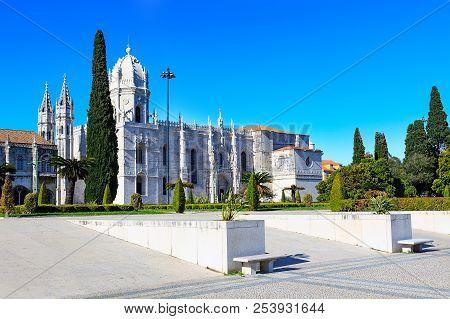 Lisbon, Portugal Park And View To Jeronimos Monastery Or Hieronymites Monastery, Famous Landmark