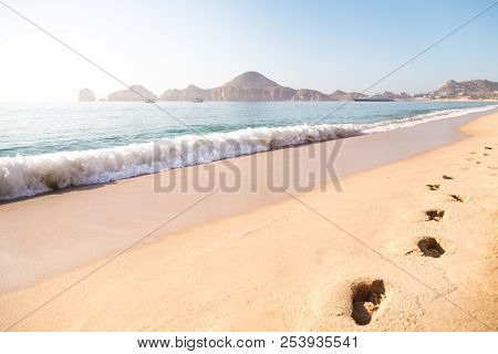 Footprints In The Sand On The Beach In Cabo San Lucas.