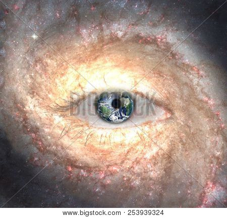 Surrealism. Woman's eye with galaxies. 3D rendering