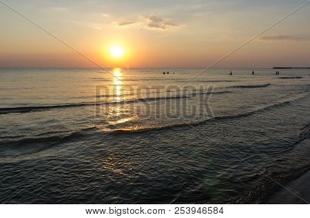 Amazing Sea Sunset. Sunset Sea Waves. Summer Sunset. Beautiful Seascape Evening Sunset Sea And Pier.