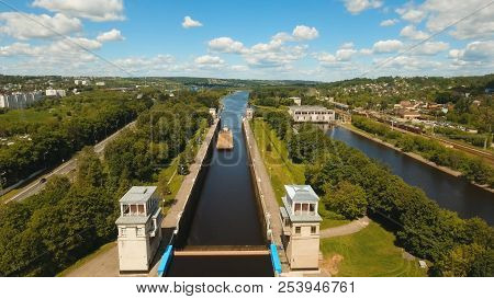 Sluice Gates On The River. Aerial View Barge, Ship In The River Gateway. River Sluice Construction,