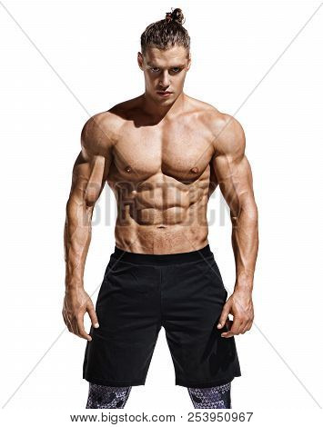 Sporty Man With Perfect Body After Training Isolated On White Background. Strength And Motivation