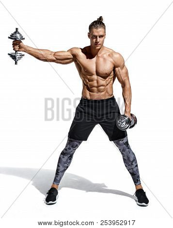 Strong Man Doing Exercise With Heavy Weight Dumbbells. Photo Of Young Man With Good Physique Isolate