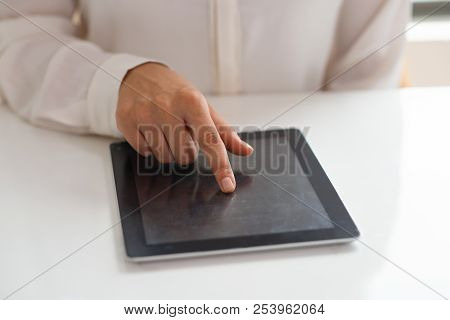 Unidentified Female Employee Using Touchpad. Hand Of Businesswoman Sitting At White Table And Pushin