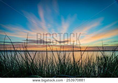 Blue Sky And Orange Sunset Over A Lake In Australia
