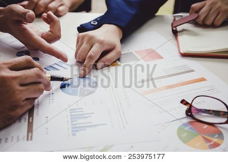 Asian business adviser meeting to analyze and discuss the situation on the financial report in the meeting room.Investment Consultant,Financial Consultant,Financial advisor and accounting concept poster