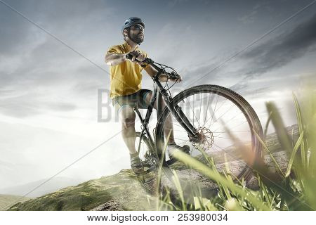 The Young Fit Men In Helmet Conquering Mountains On A Bicycle. The Bike, Nature, Bicycle, Sport, Cyc