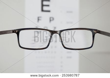 Close-up Of Eyeglasses For Vision, Pointing At Table To Check View. The Concept Of Poor Vision, Blin