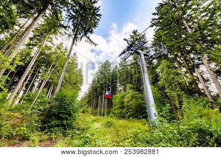 Ski Lift In The Summer In A Green Forest Going To The Top Of A Mountain