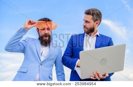 Businessman With Laptop Serious While Business Partner Ridiculous Glasses Looks Funny. How Stop Play
