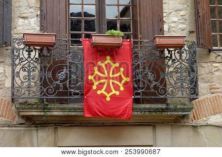 The Occitania Flag Hung On A Balcony.