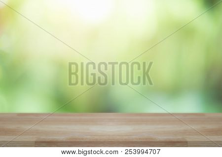 Empty Wooden Desk Of Free Space And Spring Time With Blurred Background Of Home Garden For A Caterin