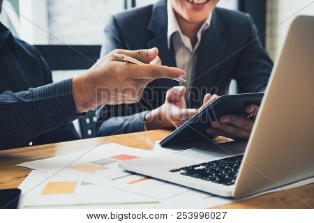 poster of Asian business adviser meeting to analyze and discuss the situation on the financial report in the meeting room.Investment Consultant,Financial Consultant,Financial advisor and accounting concept
