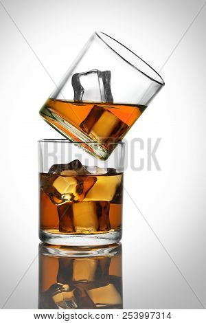 Two Glasses With Whiskey / Rum Drinks With Ice Cubes
