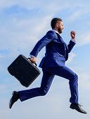 Success in business demands supernatural efforts from entrepreneur personality. Businessman with briefcase jump high motion forward. Supernatural power. Businessman formal suit make effort to succeed poster