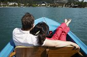 young couple boating on the lake in Austria poster
