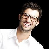 portrait of a handsome young man smiling over black background poster