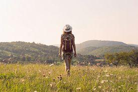 Girl in vacation. Summer vacation. Traveler girl walking through fields. Young girl traveler walking in nature. Traveler with backpack in nature. Girl traveler walk through nature in summer day. Traveler. Summer. Backpack. Girl. Walk. Nature. Vacation. Li