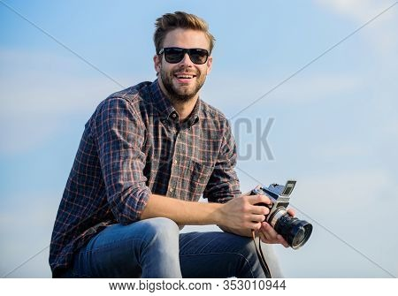 Photojournalist Concept. Travel Blogger. Reporter Taking Photo. Guy Outdoors Blue Sky Background. Vi