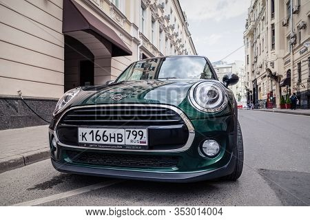 Russia Moscow 2019-06-17 Green Car Mini Cooper Is Parked On A Street Of A European City. Concept Tra