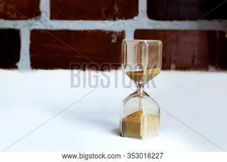 Time. An Hourglass With Sand Falling Through. Old Age, Nostalgia Concept.