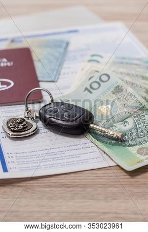 Car Sales. The Car Keys Lie On The Table Along With The Documents And Pln Money.