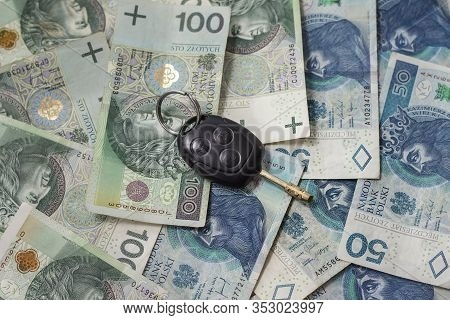The Car Keys Are On The Money. Cash In Polish Zlotys Is On The Table.